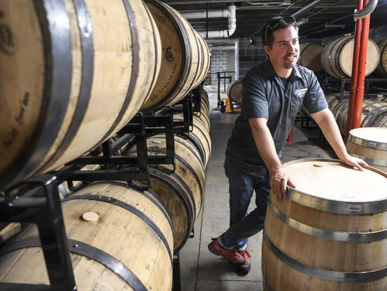 Tim Peirsant shows where the bourbon and rye whiskeys
