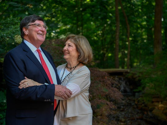 Craig Fitzhugh stands with his wife Pam as he announces