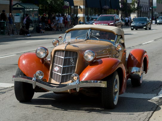 An Auburn 852 supercharged vehicle cruises down Woodward