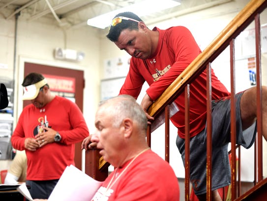 Bergen Catholic head coach Nunzio Campanile, right,