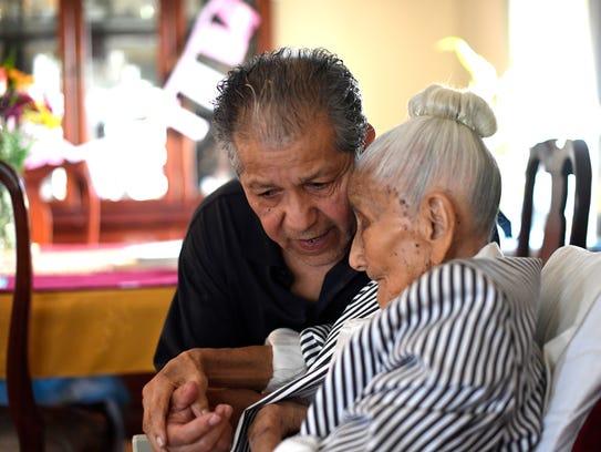 Luis Oblitas talks with his mother, Laura Oblitas,