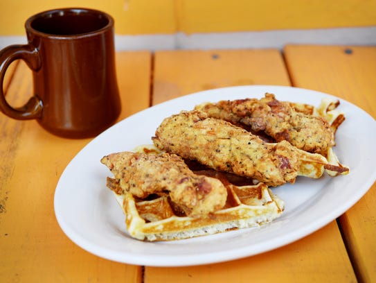 Tastee Diner's chicken and waffles with a cup of coffee