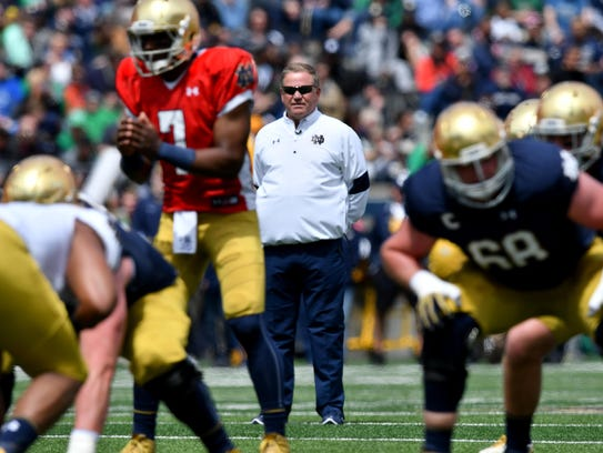 Brian Kelly (center) brought Chip Kelly to South Bend