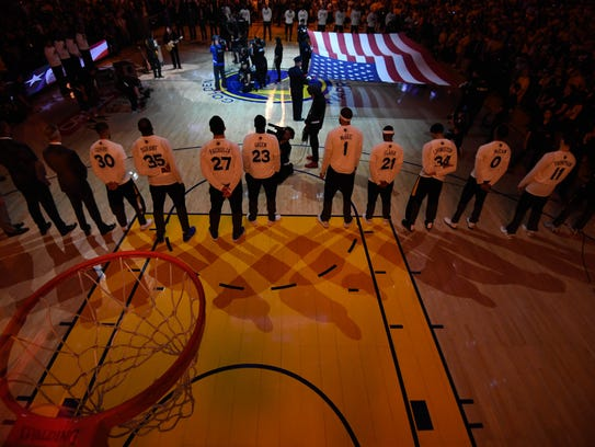 Golden State Warriors players line up for the national