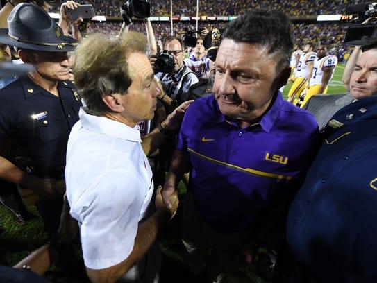 Alabama coach Nick Saban greets LSU?s Ed Orgeron following