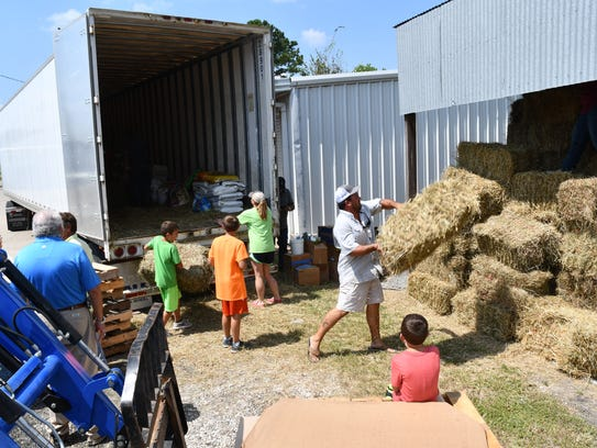 A truck of donated hay and other supplies from New