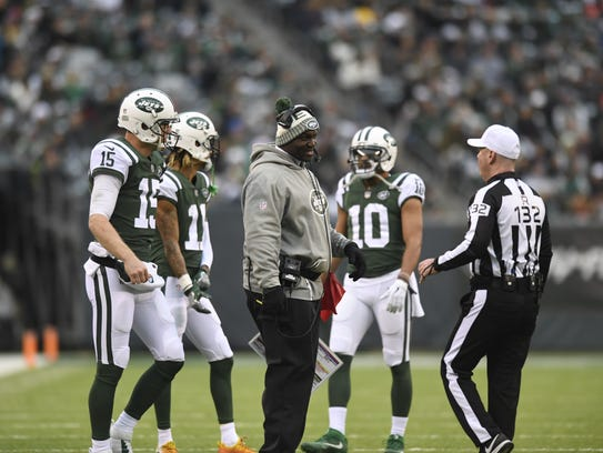 New York Jets head coach Todd Bowles talks to a referee
