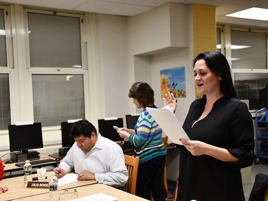 Board trustee Gina-Marie Kiely reads the oath of office.