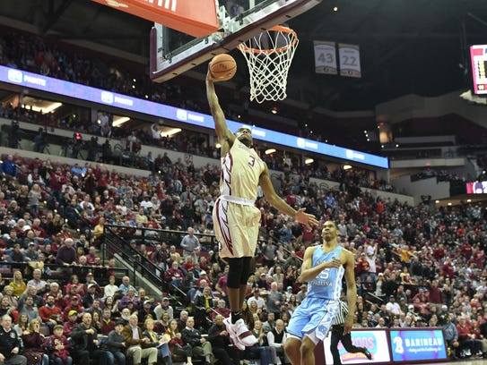 FSU sophmore guard Trent Forrest (3) dunking after