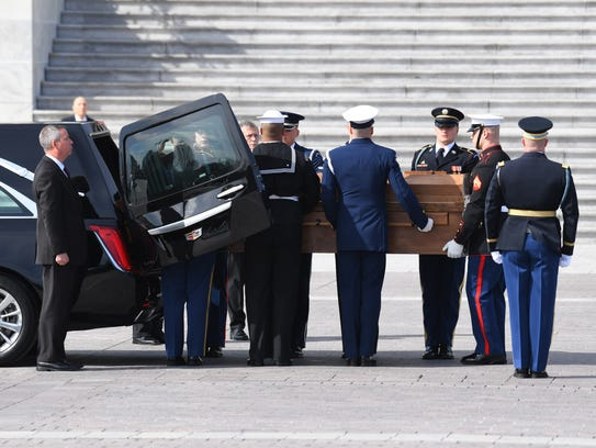 The body of evangelist Billy Graham is carried into