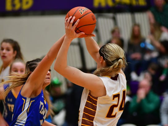 West Central's Ashlyn Macdonald tries to steal the