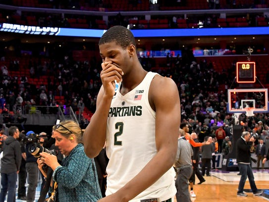 Jaren Jackson covers his face while leaving the floor