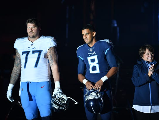 Tennessee Titans Taylor Lewan and Marcus Mariota with