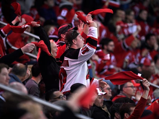 New Jersey Devils fans cheer as they face the Tampa