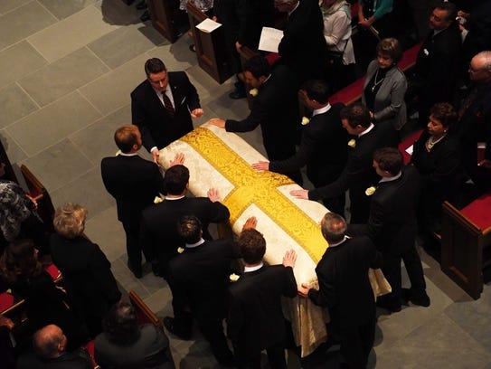 Bush grandsons as pallbearers guide the casket of their grandmother Barbara Bush into St. Martin''s Episcopal Church.