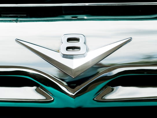 A V8 logo on a vintage truck at the 44th annual Street