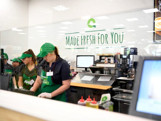 Employees make deli sandwiches at the new concept QuickChek