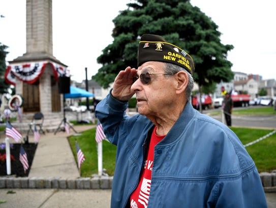 WWII and Korean War Navy veteran John Benanti salutes