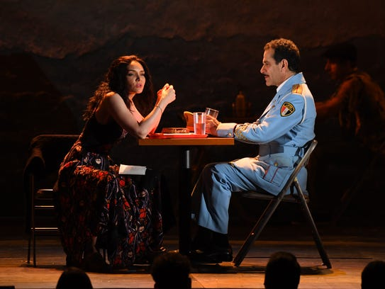 """Katrina Lenk (left) and Green Bay native Tony Shalhoub perform a scene from the musical """"The Band's Visit"""" at the 72nd Tony Awards at Radio City Music Hall. """"The Band's Visit,"""" based on a 2007 Israeli movie, was the big winner at Sunday night's Tonys, including awards for both Shalhoub and Link."""