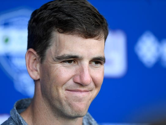 New York Giants quarterback Eli Manning talks to the