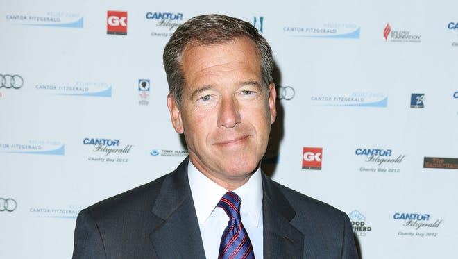 """FILE - This Sept. 11, 2012 file image released by Starpix shows Brian Williams at the Cantor Fitzgerald Charity Day event in New York. NBC """"NBC """"Nightly News"""" anchor Williams has admitted he spread a false story about being on a helicopter that came under enemy fire while he was reporting in Iraq in 2003. Williams said on """"Nightly News"""" on Wednesday, Feb. 4, 2015, he was in a helicopter following other aircraft, one of which was hit by ground fire. His helicopter was not hit. (AP Photo/Starpix, Andrew Toth, File)"""