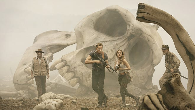 "John Goodman as Randa, Tom Hiddleston as Conrad, Brie Larson as Mason and John C. Rielly as Marlow in Warner Bros. Pictures' and Legendary Pictures' action adventure ""Kong: Skull Island,"" a Warner Bros. Pictures release."