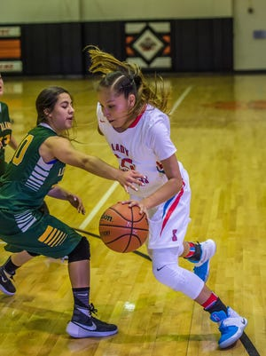 Shiprock's Tanisha Begay drives past Los Alamos' Sophie Royal during a game on Friday, Jan. 7,  at Lillywhite Gym in Aztec.