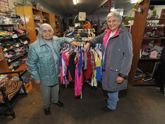 Lindsay Strathmore Coordinating Council volunteers Teresa Serna and Dorothy Coles inside the thrift shop on Tuesday, January 5, 2016.