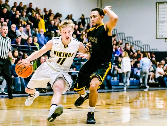 Brandon Allen ,11, of Haslett drives to the basket