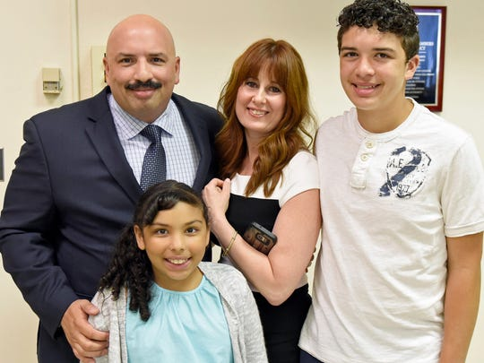 Chief Roland Camacho is seen with his girlfriend, Tiffany Tidona, and his children, Logan and Isabella. Chief Roland Camacho was sworn in by town council as Chambersburg's newest Chief of Police on Monday, June 27, 2016.
