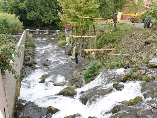 A sluiceway support system is being installed at the