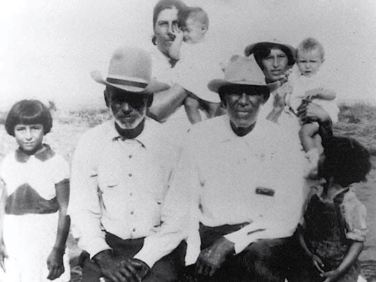 A family photo shows Arlinda Valencia's grandfather, Rosendo Mesa, left, and great-grandfather, Longino Flores, right, in Porvenir, Texas. Longino Flores was among the 15 men and boys killed in the 1918 massacre.