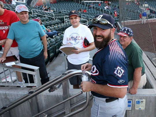 Reno Aces first baseman Cody Decker talks with fans