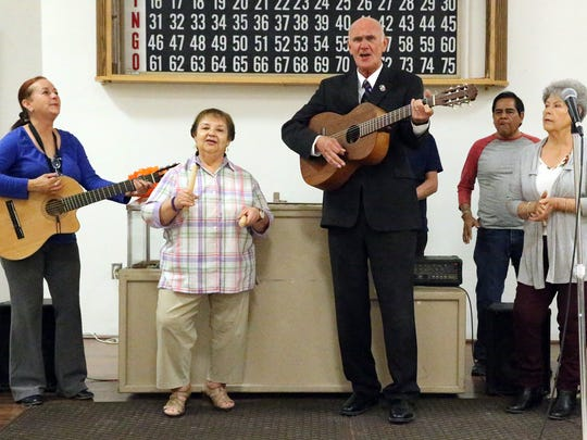"County judge candidate John Cook sings ""La Bamba"" with a musical group Tuesday at the South El Paso Senior Center."