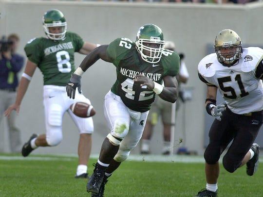 Michigan State linebacker Mike Labinjo blocks and runs