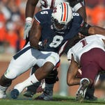 Mississippi quarterback Bo Wallace (14) throws a pass as Auburn linebacker Justin Garrett (26) rushes during the NCAA football game between Auburn and Mississippi at University of Mississippi in Oxford, Miss., on Saturday, Nov. 1, 2014.