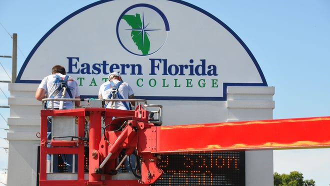 Brevard Community College's name officially changed to Eastern Florida State College on July 1, 2013. Here, Patrick Lantz and Jerrid Watson from Art Kraft Sign Co. in Palm Bay install a new sign at the Cocoa campus on Clearlake Road.