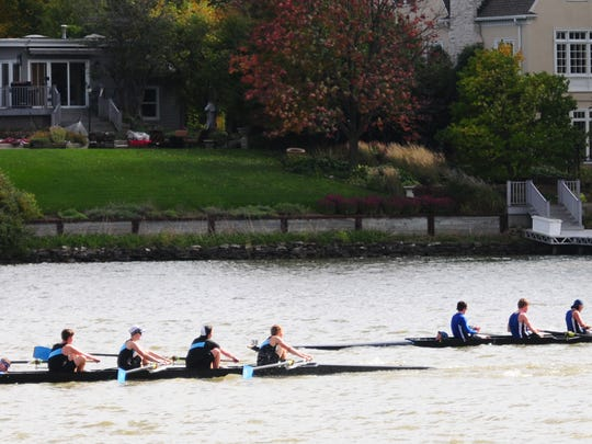 Juniors race on the Fox River during the Tail of the Fox regatta Sunday at St. Norbert College.