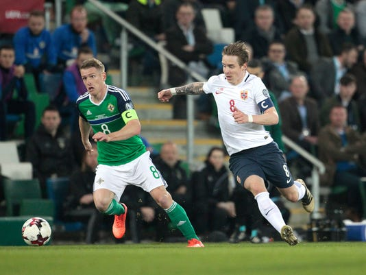 Northern Ireland's Steven Davis, left, and Norway's Stefan Johansen during their World Cup Group C qualifying soccer match at Windsor Park Stadium in Belfast, Northern Ireland, Sunday, March 26, 2017. (AP Photo/Peter Morrison)