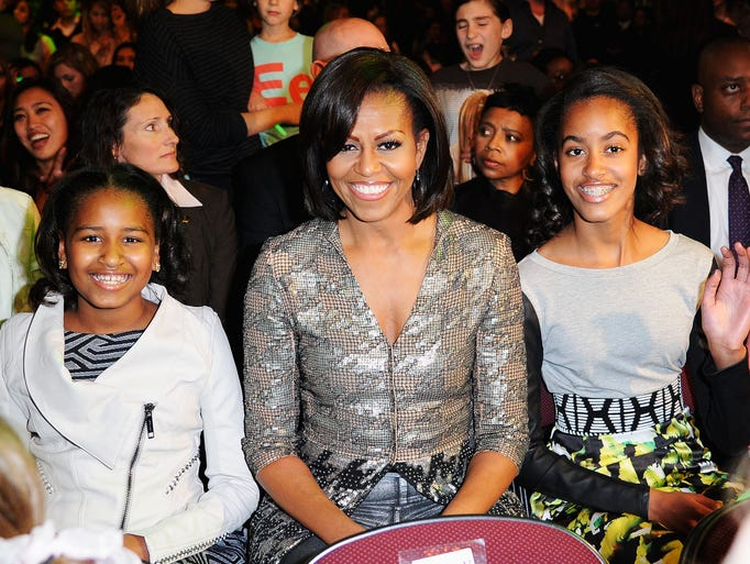 From left, Sasha Obama, First Lady Michelle Obama and