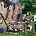 MIKE LAWRENCE / THE GLEANER Henderson City firemen at the scene of a house explosion at 121 Mill Street in Henderson Monday evening. Officials at the scene reported that three people were injured, one transported to Methodist Hospital with serious injuries, May 2, 2016.