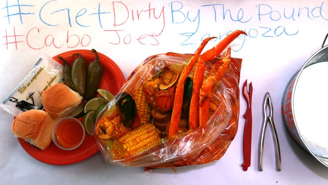 The Cajun-style combination seafood boil at Cabo Joe's, 1700 N. Zaragoza, offers a messy, tasty treat. The boil includes crab, shrimp, lobster, mussels, sausage, red potatoes and corn on the cob.