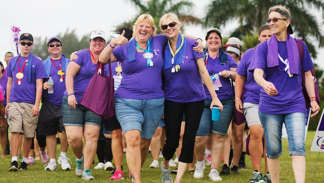 "Angela Teleweck, center left, and Helga Thibodeaux were among those taking part in the Fort Myers Relay for Life festival Saturday at Lakes Regional Park. ""She was there for me,"" said Thibodeaux, a lung cancer survivor, of her caregiver, Teleweck."