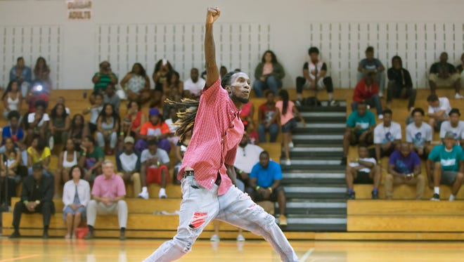 Toni Bridley, of True Heroes Under God, performs an interpretive dance Sunday at the 9th Annual James Brunson Celebrity Basketball Classic at Dunbar High School in Fort Myers. Proceeds from the event fund local scholarships and benefit the families of Sean Archilles and Stef'an Strawder. Archilles and Strawder were killed in the Club Blu shooting in July 26.