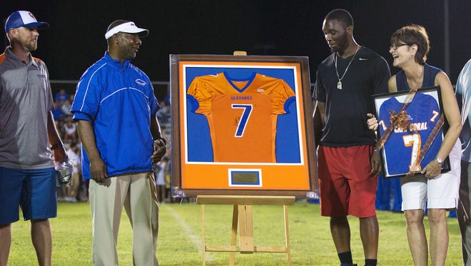 Cape Coral High school retired the jersey of former football player Jaylen Watkins, third from left, during halftime of Friday's game against Ida Baker at Cape Coral High School in Fort Myers. Watkins graduated in 2010 and currently plays for the Philadelphia Eagles.