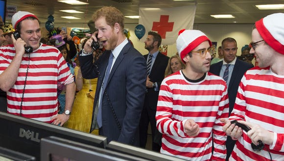 That's Prince Harry pressing for pounds on the phones