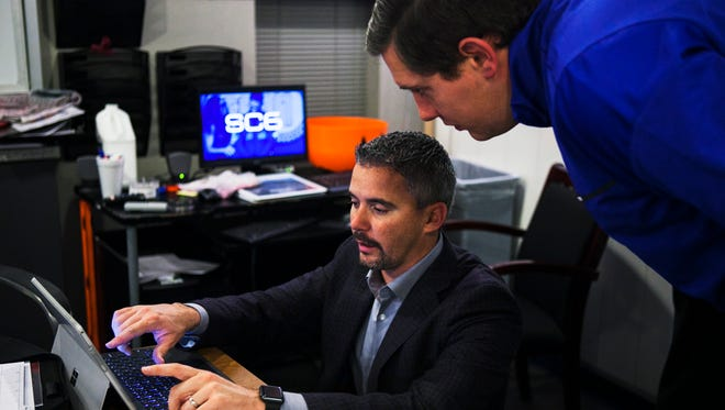 Head coach Mike Norvell (center) talks to Matt Haron, director of football video, during National Signing Day in the Athletic Office Building at University of Memphis on Wednesday, Feb. 1, 2017.