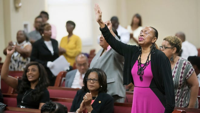Patricia D. Thomas, right, worships on Sunday during Friendship Missionary Baptist Church's 106th anniversary celebration at the church in Fort Myers.