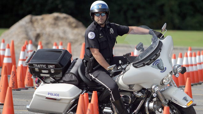 Hendersonville Officer Chris Rapp rides around the cones at the Police rodeo in Gallatin, TN on Saturday, July 27, 2018.