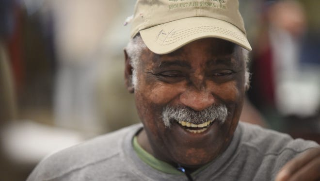 Charles Frank, of Clarksville, smiles while working on a fly at the 2015 Sowbug Roundup. The 20-year U.S. Air Force veteran was among the more popular tyers for onlookers Friday.